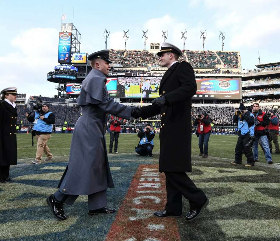 Darien's Ian Burgoyne, right, is Brigade Commander. At the Army/Navy game, Ian lead the midshipmen onto the field in Philadelphia.  On left is Army's First Captain David Bindon. — Photo courtesy U.S. Navy