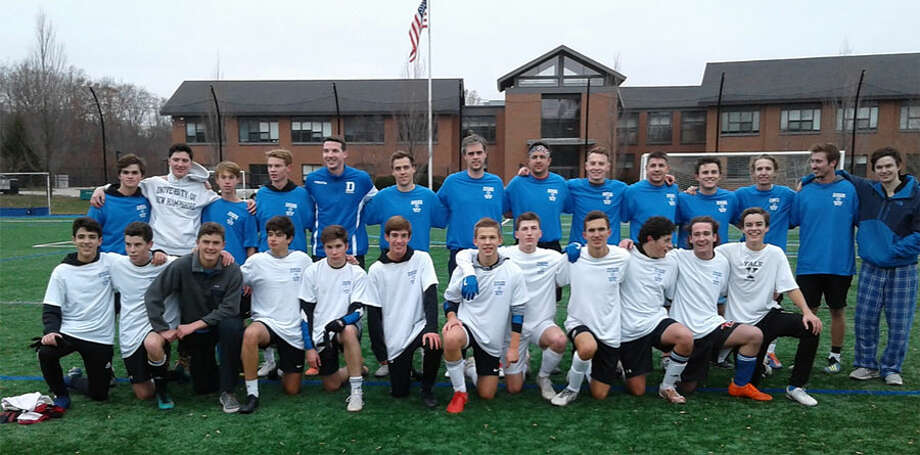 Darien soccer players past and present pose for a photo after the annual alumni game at Darien High School on Nov. 24.