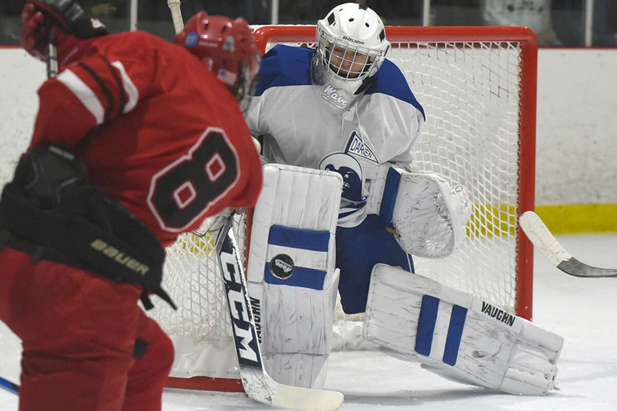 Darien goalie Henri Pfeifle squares up the puck during a Wave contest against Greenwich last winter. - Dave Stewart photo