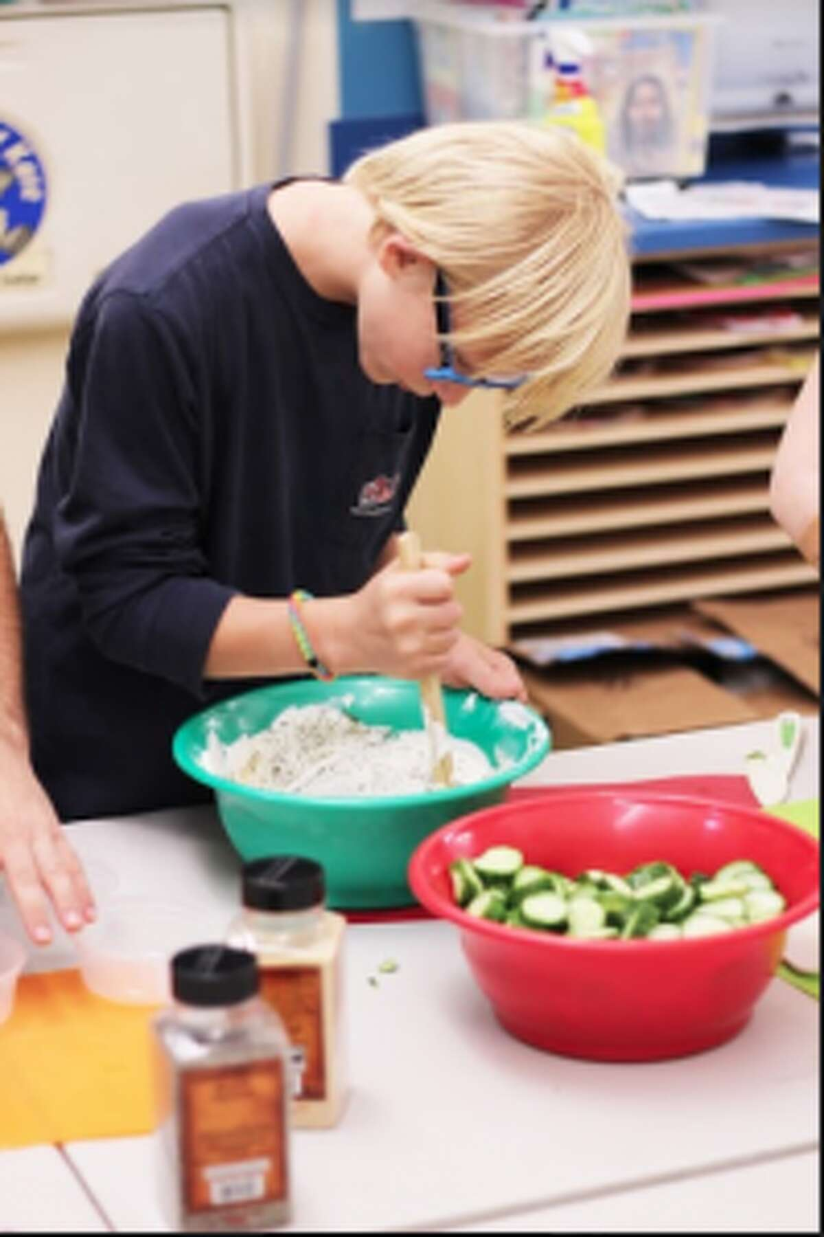Connor O'Neill, 12, helps with snack preparation with the Darien YMCA's Innovative Vocations program.