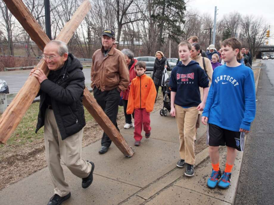 The Good Friday walk tradition in Darien is one of the many ways Darien's churches collaborate. It forged a friendship between St. Luke's Rev. David Anderson and First Congregational Senior Minister Dale Rosenberger.
