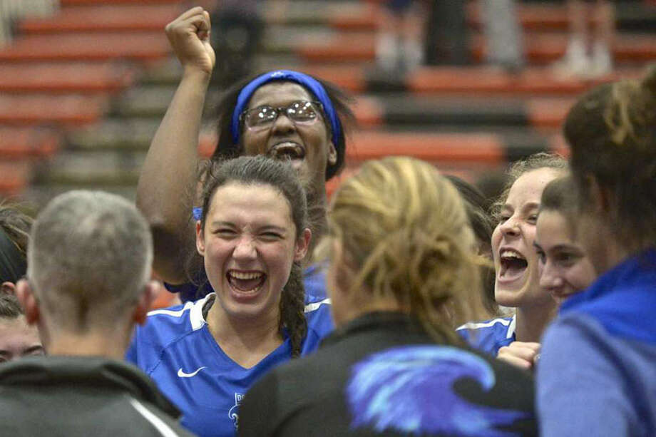 Darien captain Cristina Escajadillo (14, center) and Hassana Arbubakrr (12) are all smiles while listening to head coach Laurie Larusso after the Wave defeated Southington 3-2 in the CIAC Class LL semifinals at Shelton Wednesday. — H John Voorhees III/Hearst Connecticut Media photo