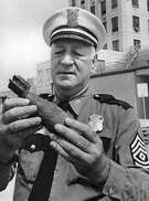 From the May 18, 1966, Chronicle: Houston Police Department demolition expert Sgt. J.E. Armstrong holds a World War I vintage bomb which was discovered Tuesday. It is of the type, said Sgt. Armstrong, which was dropped by hand by pilots at about 1917. The bomb was unearthed at the San Jacinto Battleground by a man with a metal detector who was searching for artifacts. Sgt. Armstrong said he would disarm the bomb.