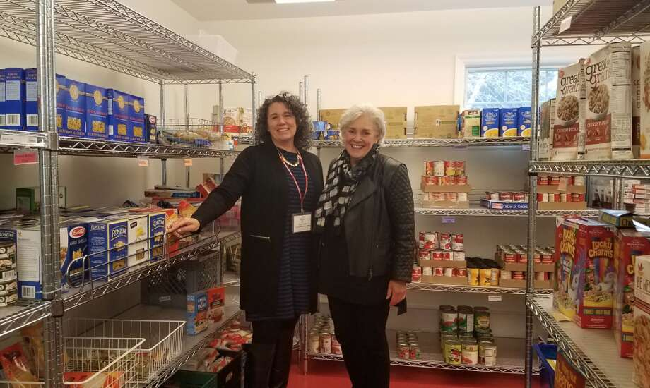 Tracy Cramer, left; chief philanthropy officer, and Ceci Maher; executive director, stand inside Person-To-Person's food pantry. — Sandra Diamond Fox photo