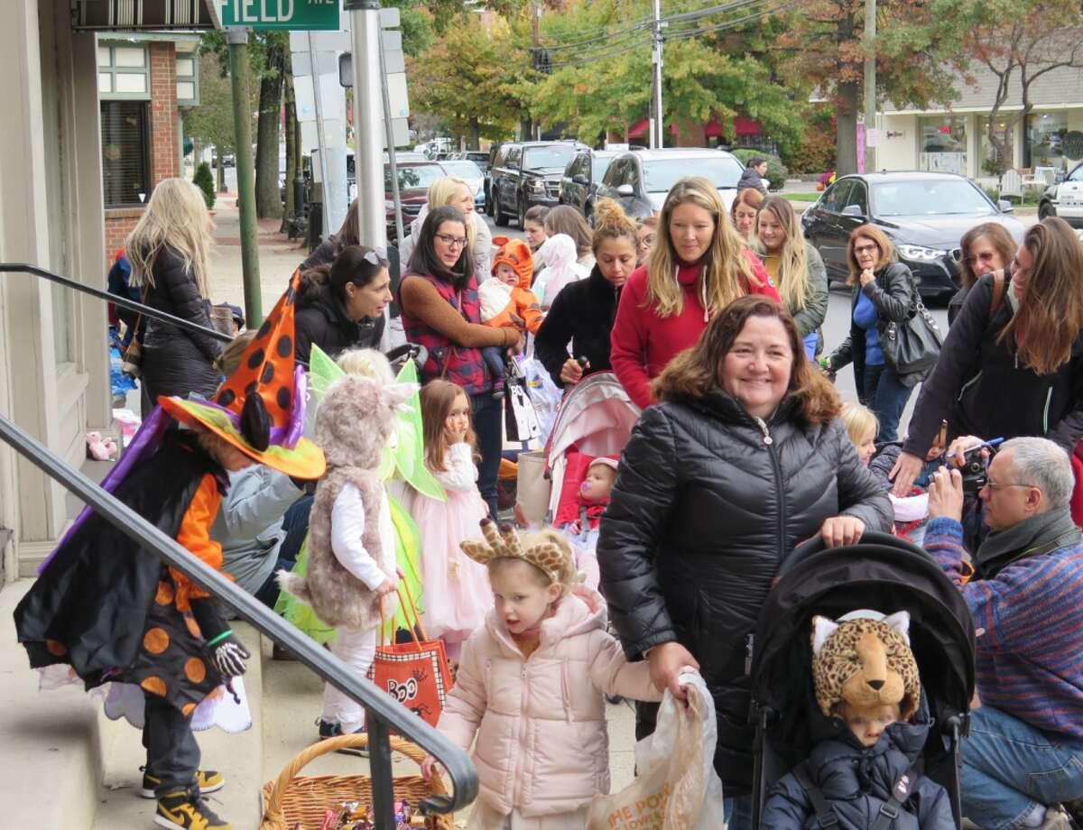 Trick-or-treaters were greeted by downtown businesses at the parade.