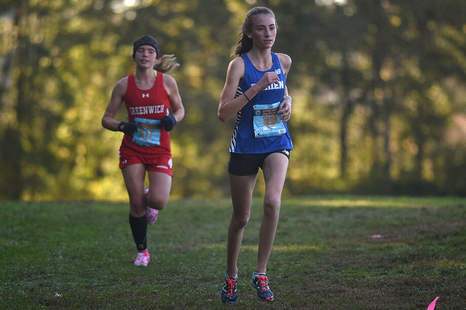 Darien freshman Mairead Clas, shown competing at the FCIAC cross country championships in October, won the 1,000-meter race at he FCIAC East Division indoor track and field championships in Wilton on Saturday, Jan. 26. — Dave Stewart photo