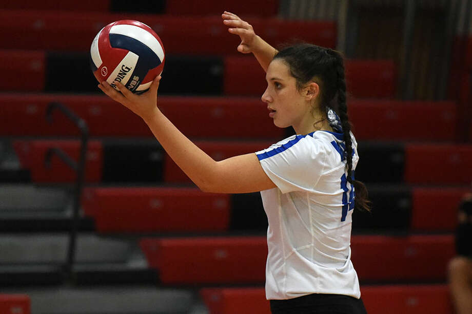 Darien senior co-captain Cristina Escajadillo gets set to serve up a winner. Dave Stewart photo