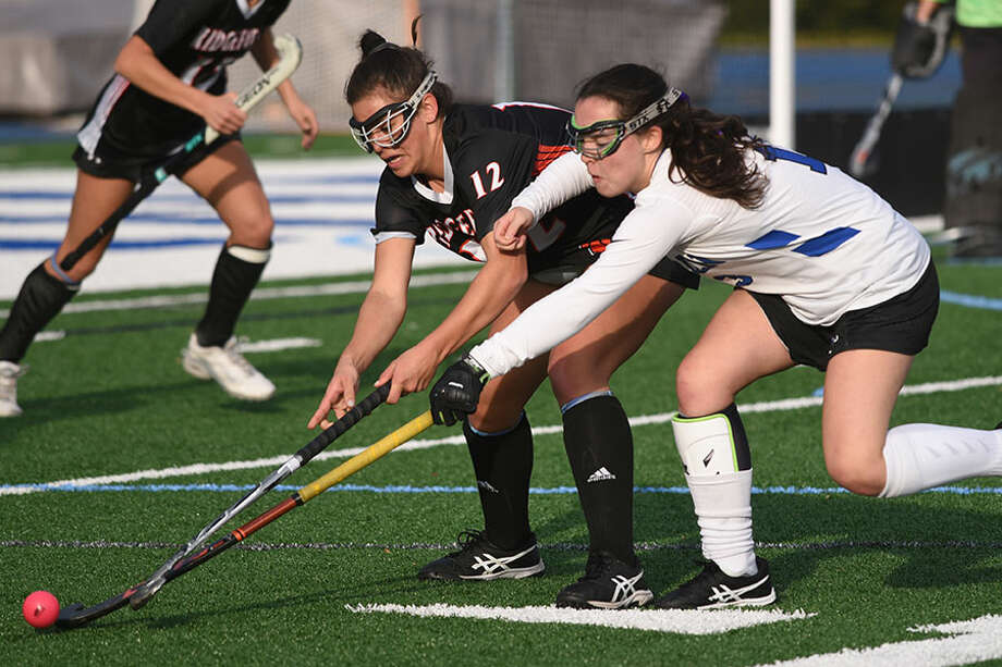 Darien's Bridget Mahoney (right) and Ridgefield's Isabella Carrozza (12) battle in the Tigers' circle during the FCIAC quarterfinals last Friday at DHS. — Dave Stewart photo