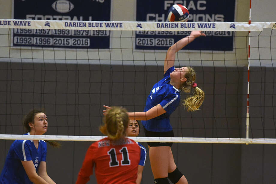 Darien senior co-captain Lindsey Bennett takes to the air during the Wave's 3-0 win over New Canaan Thursday at DHS. — Dave Stewart photo