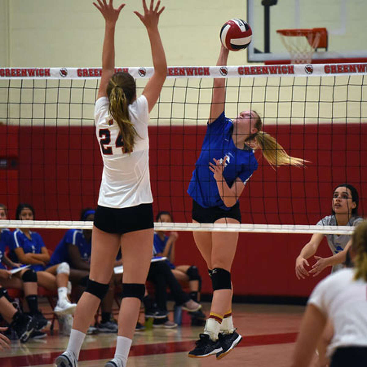 Darien senior co-captain Lindsay Bennett puts down a point during the Wave's 3-0 win over Greenwich in the FCIAC quarterfinals on Tuesday. - Dave Stewart photo