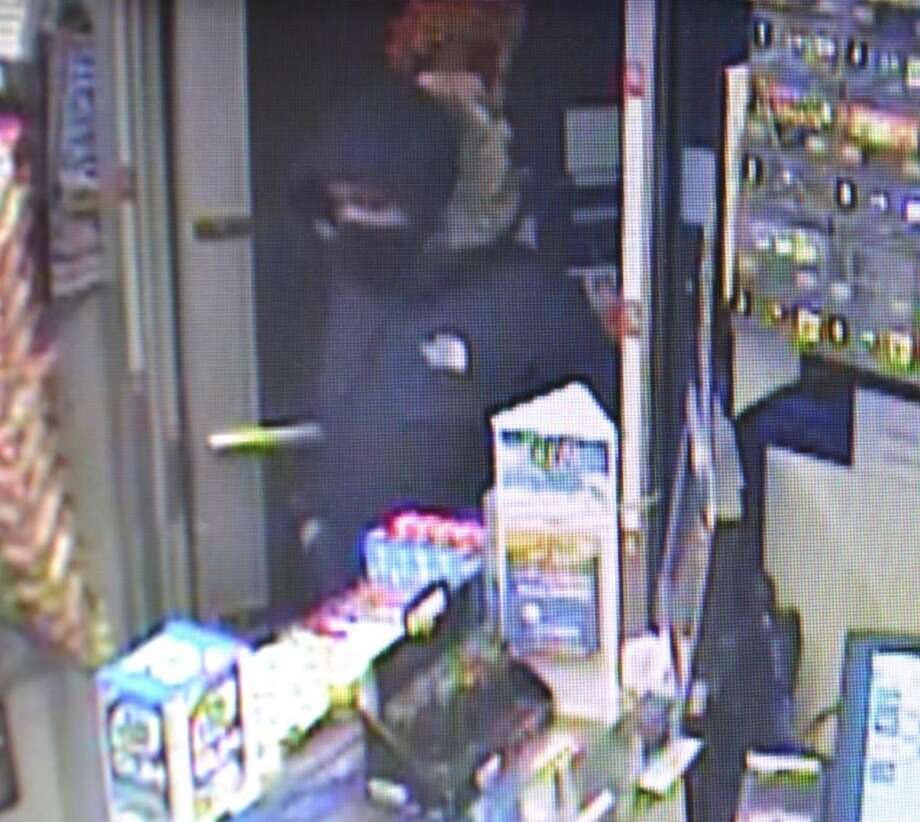 Video surveillance shows images of a suspect in a recent armed robbery in Darien.