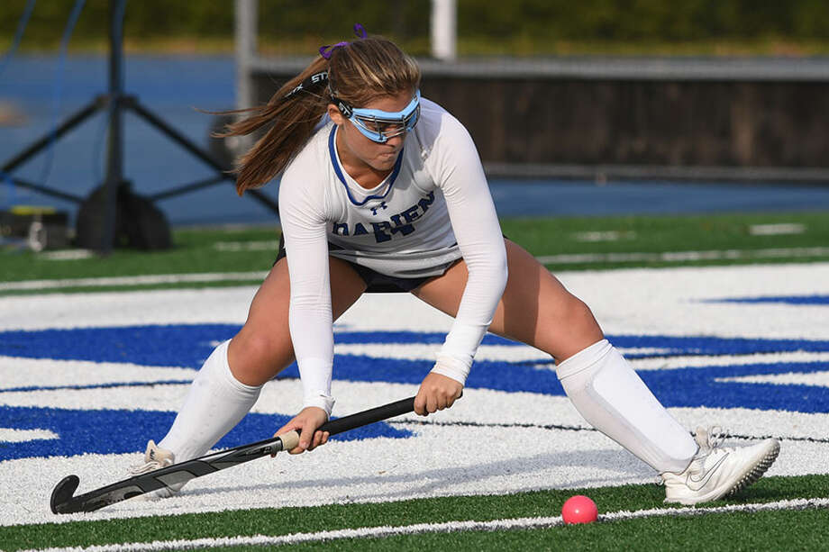 Darien's Lily Kulesz sends the ball into play on a penalty corner. — Dave Stewart photo