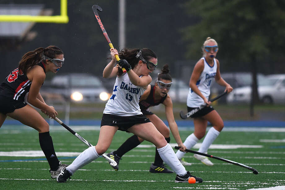 Darien senior co-captain Bridget Mahoney gets set to send the ball upfield during the Wave's win over New Canaan on Monday. — Dave Stewart photo