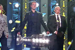Blues goalie Jordan Binnington, left, and coach Craig Berube take the stage along with other Blues players and staff, as they are honored at the NHL Awards in Las Vegas for winning the 2019 Stanley Cup.
