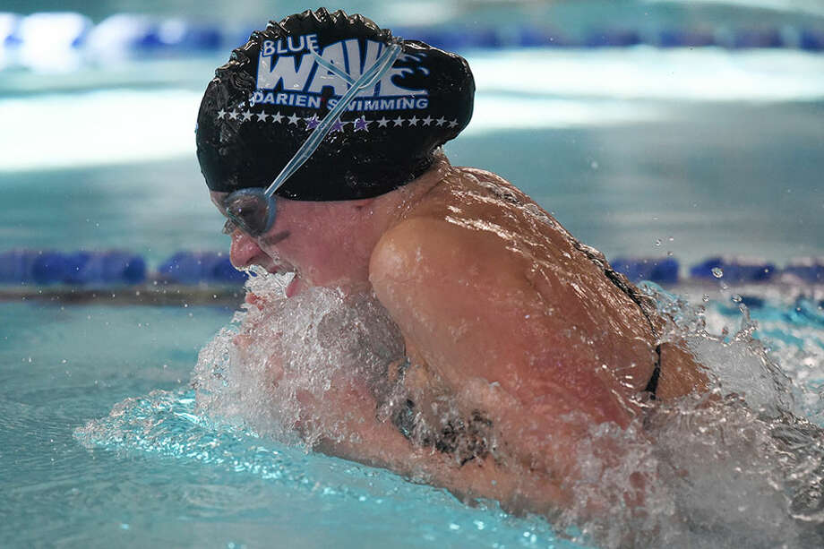 Darien's Kaitlyn Holmes competes in the 100 breaststroke during the Blue Wave's win over rival New Canaan Wednesday at the Darien YMCA. — Dave Stewart photo
