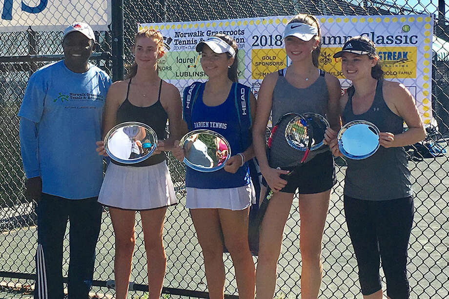 Darien's Katie Wiley (center) and her partner Grace Coale (second from left) were the girls varsity winners at the 11th annual Autumn Classic Tennis Tournament, held in Westport on Sept. 30.