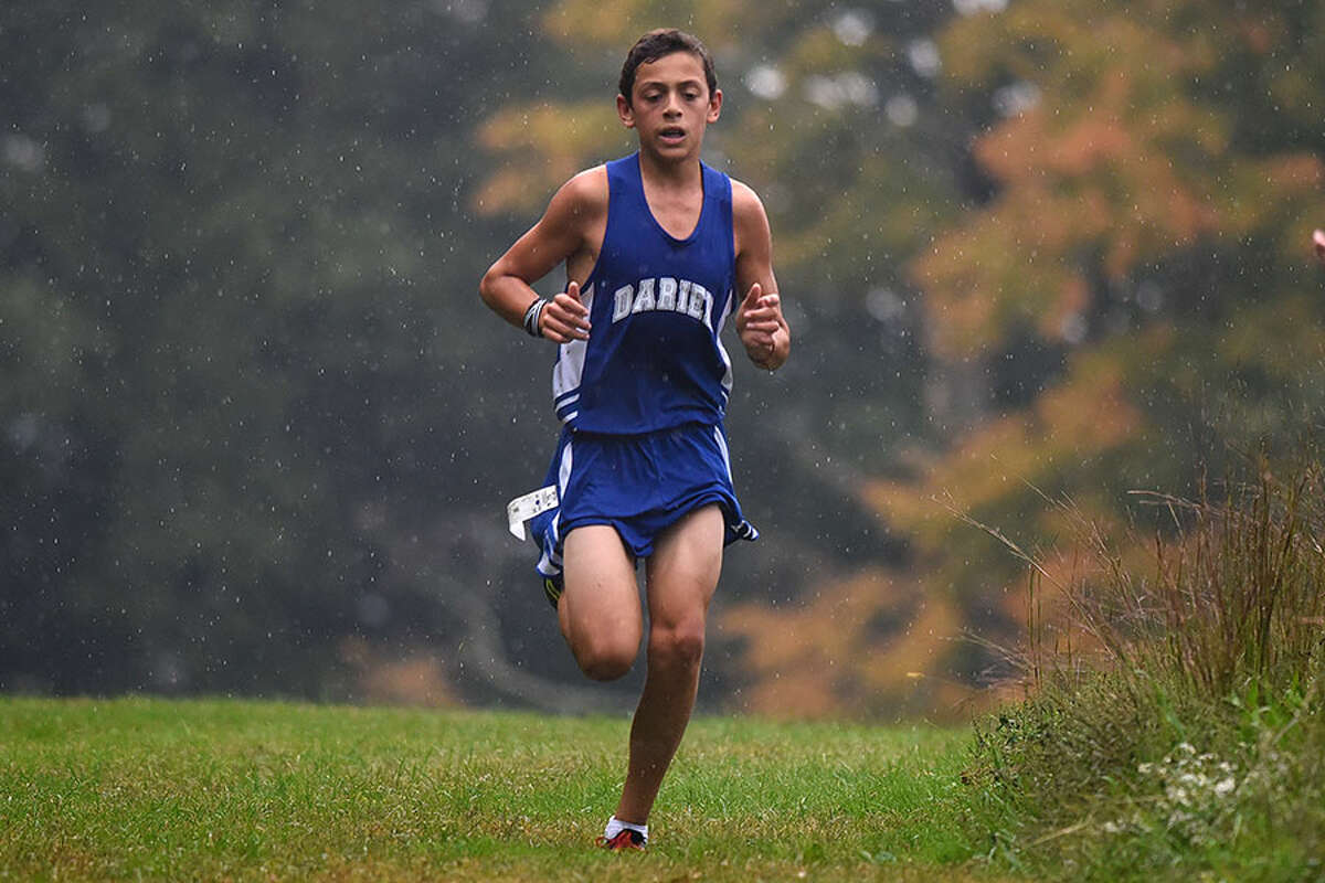 Darien's Cormac Brown races through the rain drops during a dual meet in New Canaan's Waveny Park on Oct. 2. Brown finished fourth at that meet, and was sixth at the Wickham Park Invitational on Saturday, Oct. 6. - Dave Stewart photo