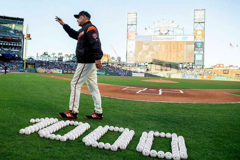 Bochy is honored for his 1,000th win as the Giants' manager before a game against the Dodgers at Oracle Park on June 7. He achieved the milestone with his team's victory over the Mets on June 4 at Citi Field in New York. Photo: Santiago Mejia / The Chronicle