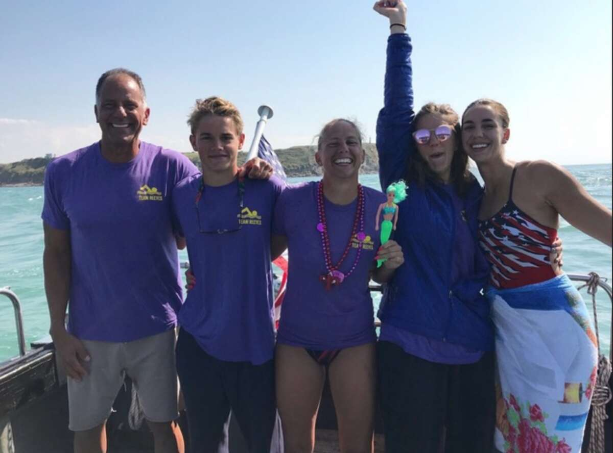 Darien High School junior Davis Tuzinkiewicz recently swam the English Channel with his team.