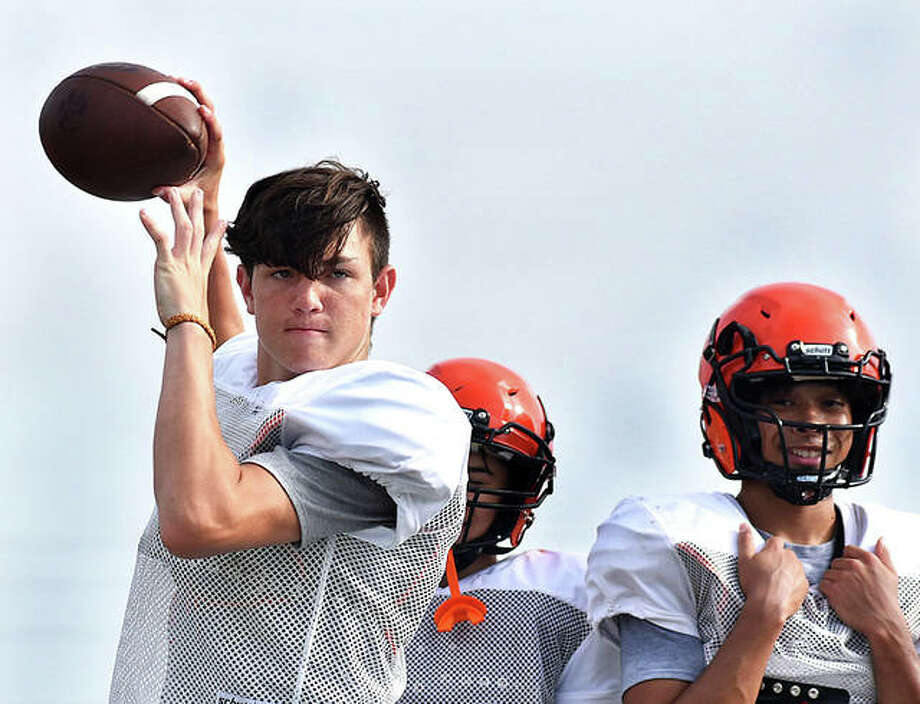 Edwardsville junior quarterback Ryan Hampton warms up on the sideline during a summer workout session at the District 7 Sports Complex in Edwardsville. Photo: Matt Kamp | For The Telegraph