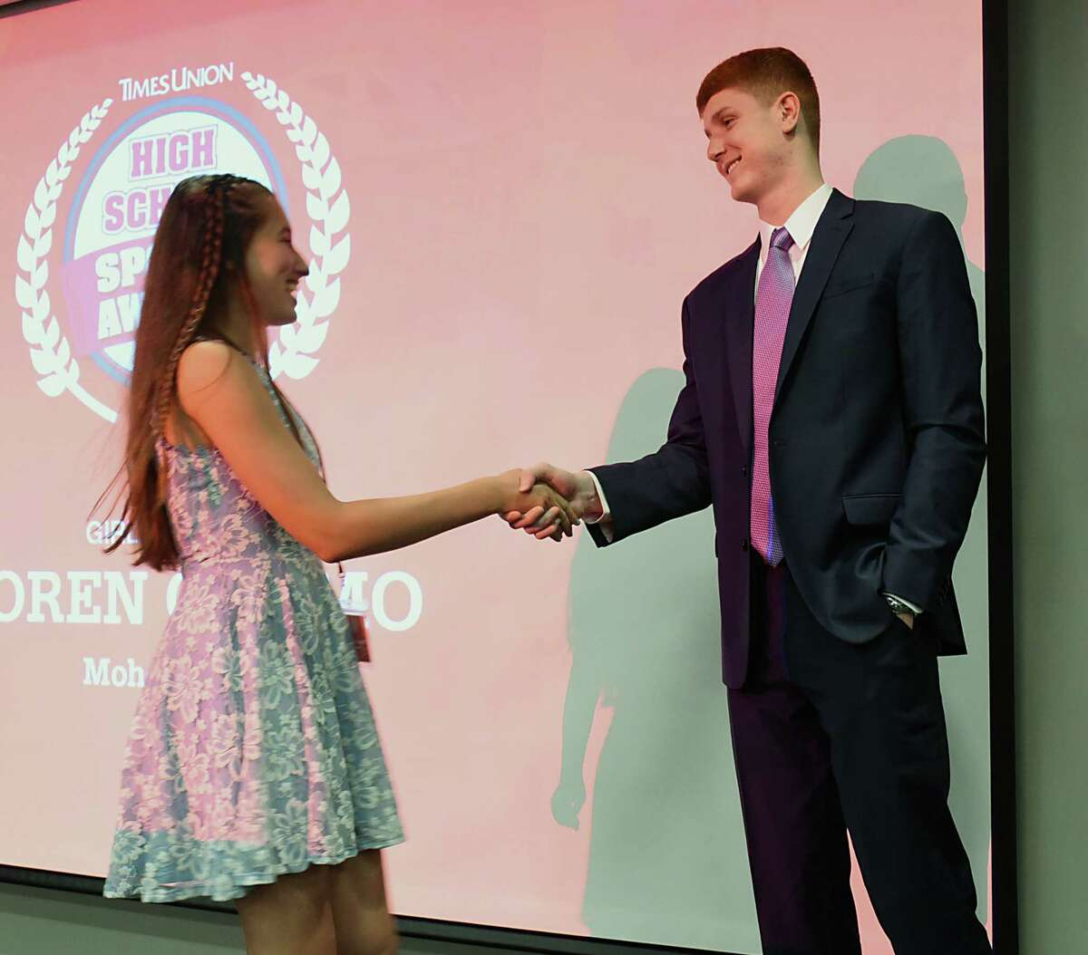 Mohonasen's Loren Cuomo shakes hands with local NBA star Kevin Huerter after she received the girls tennis award during the second annual High School Sports Awards show at the Hearst Media Center on Wednesday, June 19, 2019 in Albany, N.Y. (Lori Van Buren/Times Union)