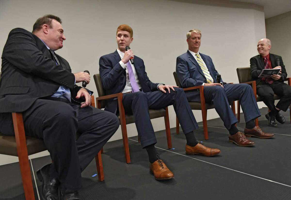Times Union sports reporter James Allen, left, and Times Union Sports editor Bill Douglas, right, have a panel discussion with local NBA star Kevin Huerter of the Atlantic Hawks, second from left, and his father Tom Huerter during the second annual High School Sports Awards show at the Hearst Media Center on Wednesday, June 19, 2019 in Albany, N.Y. (Lori Van Buren/Times Union)