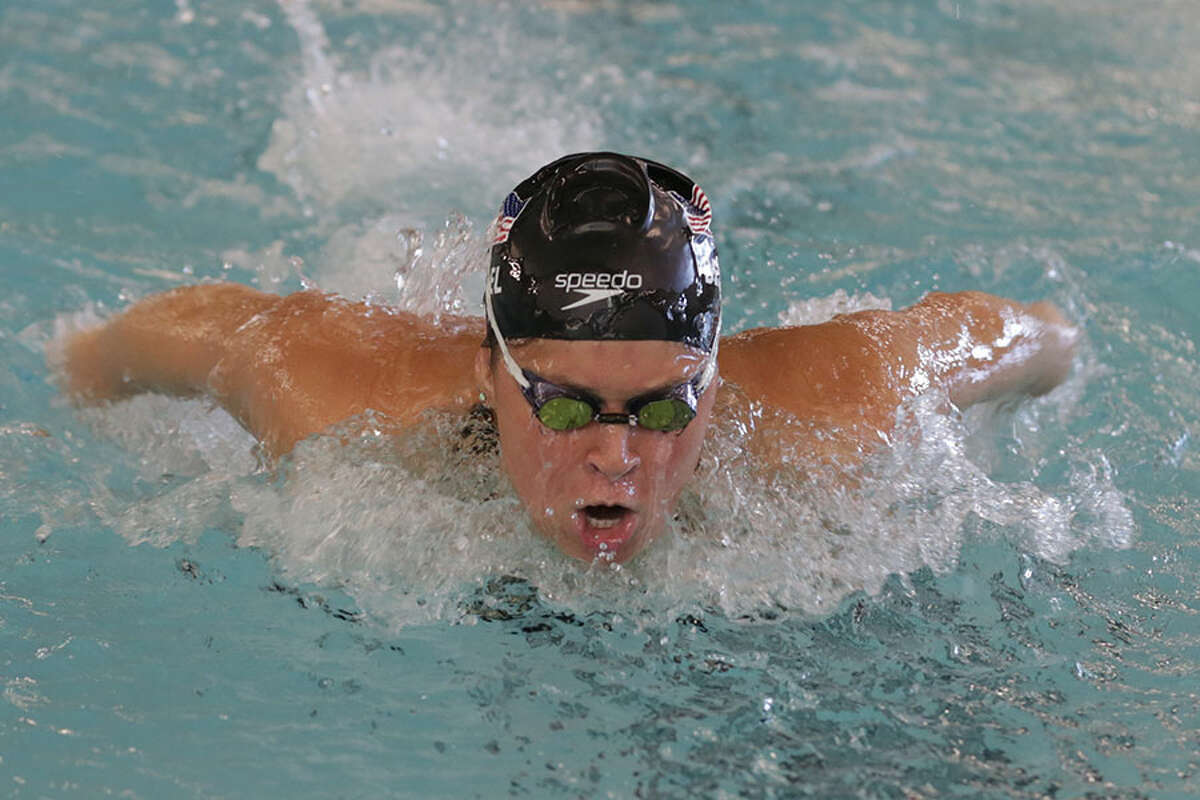 Olympic swimmer Elizabeth Beisel demonstrating the butterfly stroke during a swim clinic on Saturday, Sept. 29, at the Darien YMCA. - Pawel Frankowski/Franzvideo Photo