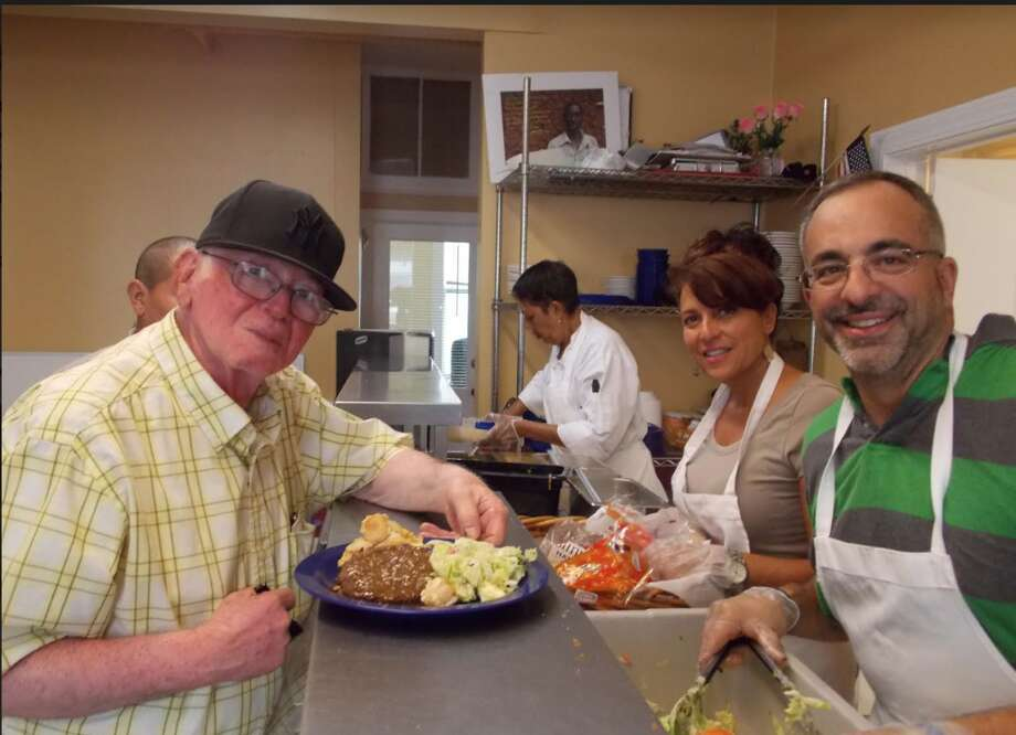 Visits in the Bridgeport Rescue Mission kitchen.