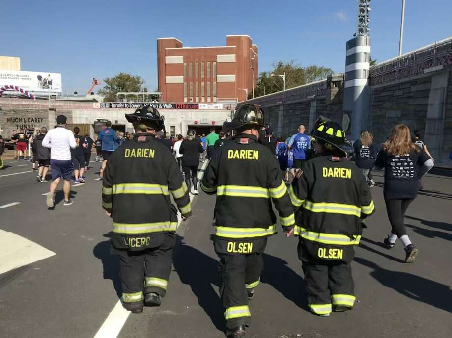 Above are Matthew Lucero, Jason Olsen, and Shannon Olsen of the Darien Fire Department during the annual Tunnel to Towers run.  Not pictured is Scott Roney.