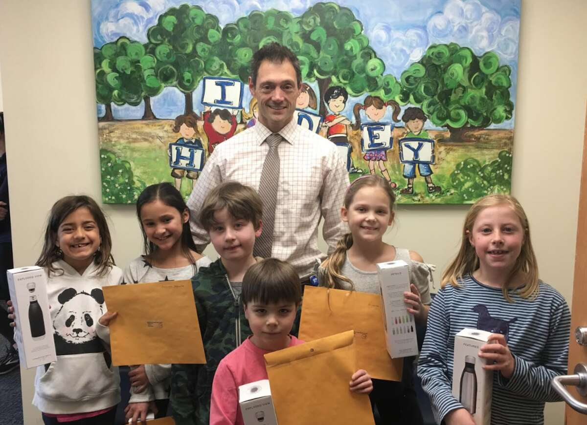 Hindley principal DJ Colella with music contest winners in February.