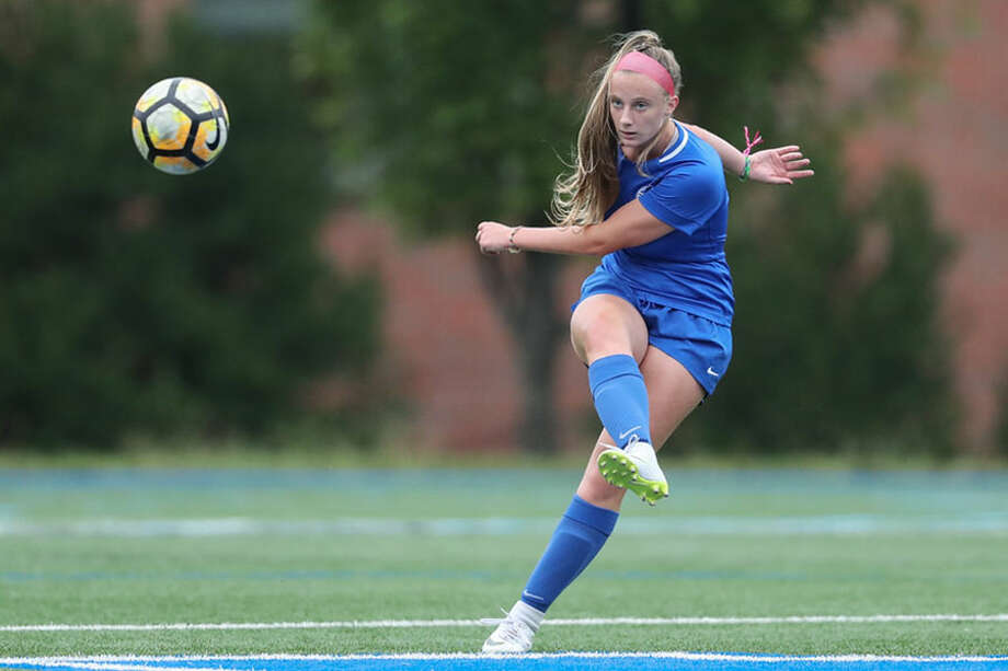 Darien's Nathalie Bravo sends the ball upfield during a recent soccer game at DHS. Bravo scored on a free kick to forge a 1-1 tie with McMahon on Thursday, — Darien Athletic Foundation photo / (c)Mark Maybell