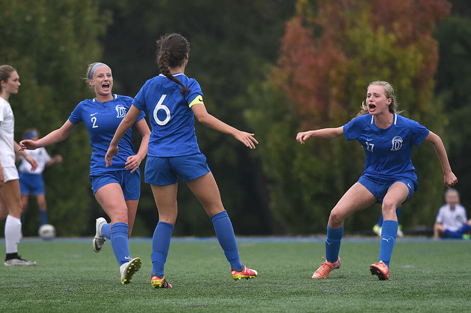 The Darien Blue Wave celebrates after Eilanna Dolan (6) scored the game-tying goal against Wilton on Thursday. On left is Nathalie Bravo (2) and on right is Maggie Ramsay (27). — Dave Stewart photo