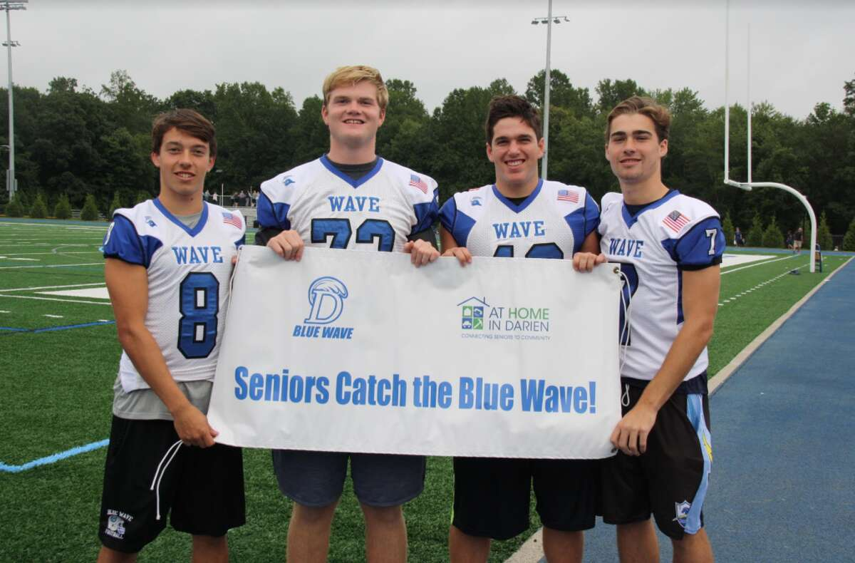 The 2018 Darien High School Football Captains extend an invitation to seniors to attend home games. Blake Cellar, left, Willy Keating, Connor Fay and Bruce Ferguson.