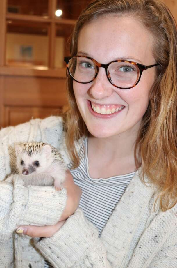 Gaby Highton, a senior at Darien High School, who won the hedgehog naming contest, along with Percy