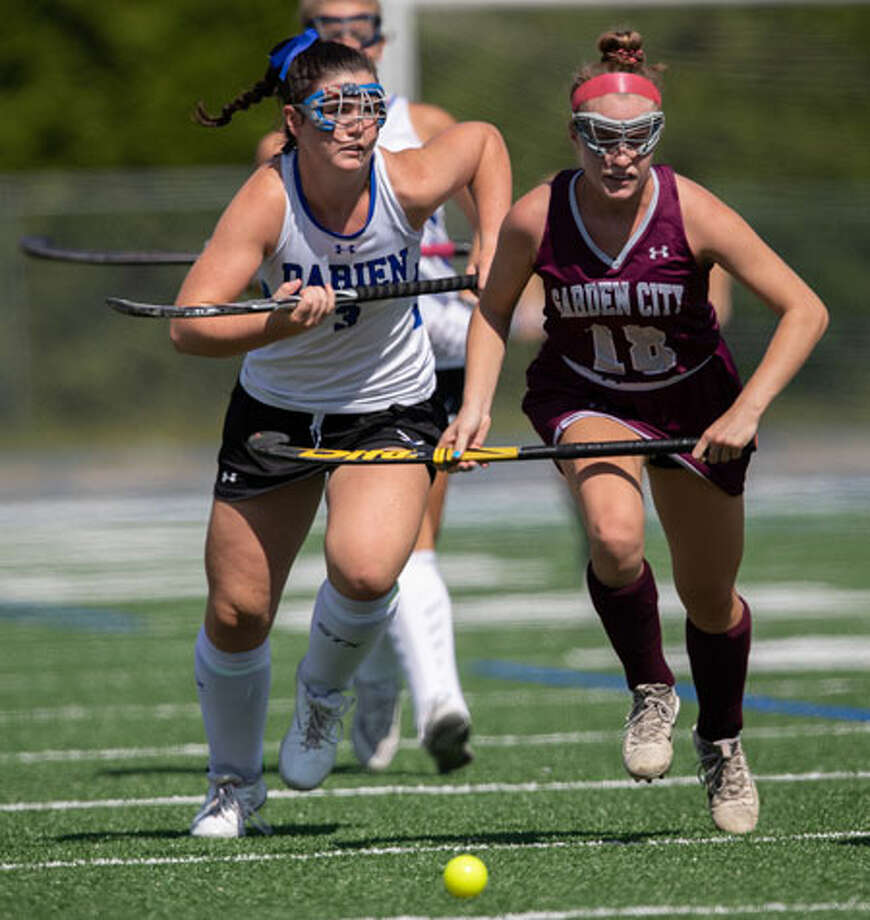 Catie Duggan races up field during the Blue Wave's field hockey game against Garden City on Saturday. — Darien Athletic Foundation photo / (c)Mark Maybell