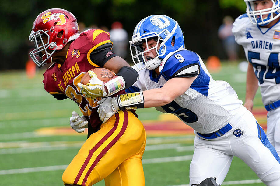 Darien's Sam Wilson (9) tackles St. Joseph's Jaden Shirden during Saturday's football game at Dalling Stadium in Trumbull. — David G. Whitham photo / DGWPhotography