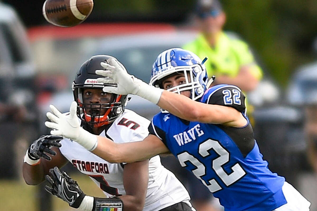 Darien's Jackson Peters (22) lines up a catch during a football game against Stamford in Darien last September. - Matthew Brown/Hearst Connecticut Media