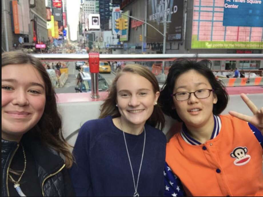 Sophomores Sophie Hill and Hailey Dineen ride the double decker bus in New York City with one of the exchange students — Courtesy Darien High School's newspaper, the NEIRAD