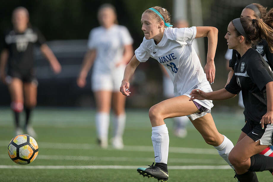 Ellen Harnisch races ahead to get the ball during a Darien victory last fall. — Darien Athletic Foundation photo / (c)Mark Maybell