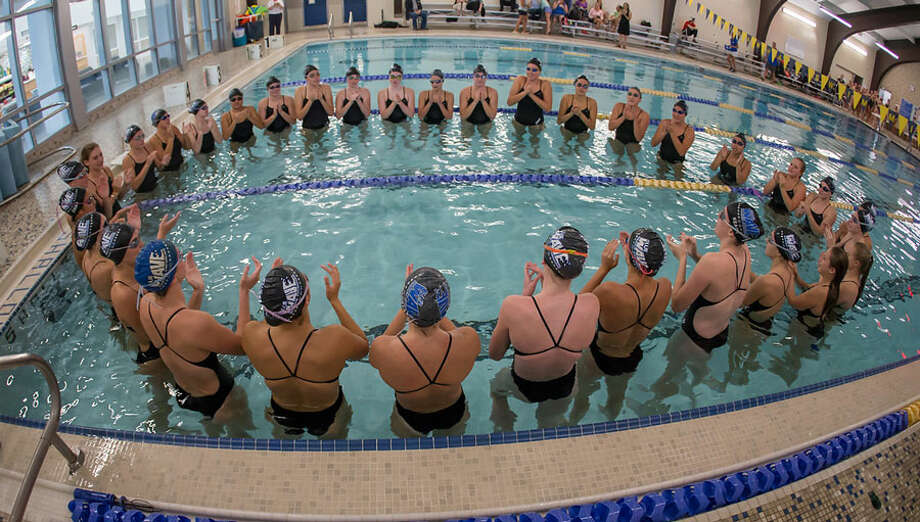 The Darien Blue Wave swimmers and divers in the pool as a team during a competition last year. — Darien Athletic Foundation photo / (c)Mark Maybell