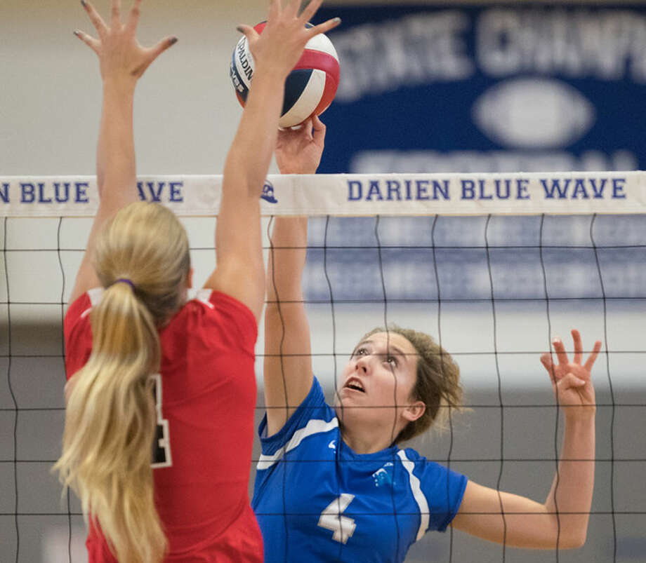 Darien's Lindsey Fay plays the net during the Wave's match against Greenwich last fall. — Darien Athletic Foundation photo / (c)Mark Maybell
