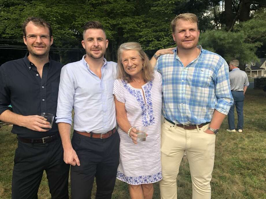 Shirley Nichols, retiring Darien Land Trust executive director, with her family, Ben, Will and Luke at the land trust's recent Farm to Table dinner.