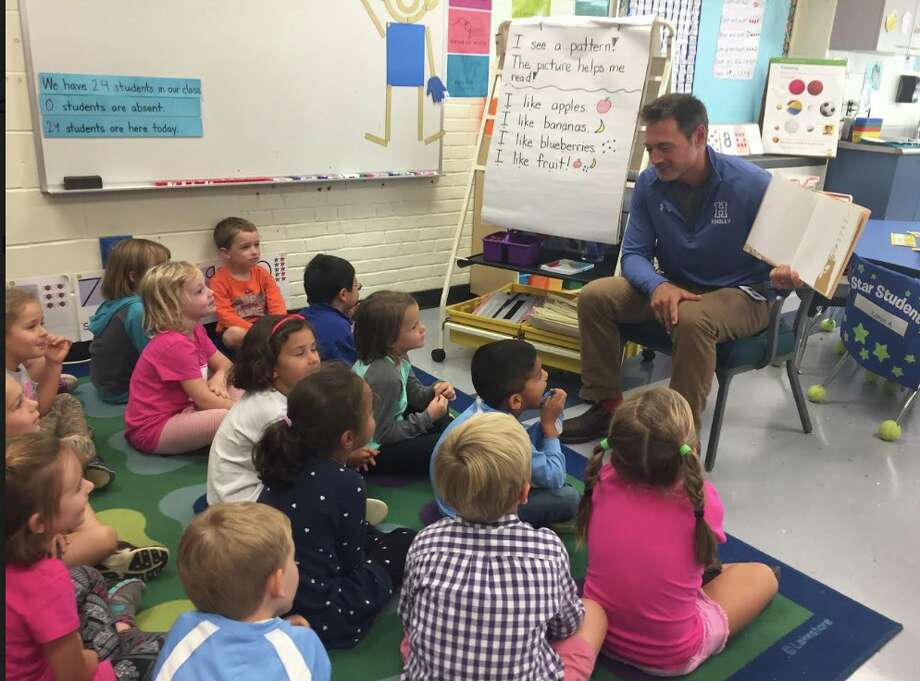 Hindley School principal Colella reading A Bear and His Boy, to a group of kindergarten students in Ms. DiCarlo's class in September 2017. Colella is on leave for the start of the 2018/19 school year as per interim Schools Superintendent Elliott Landon.