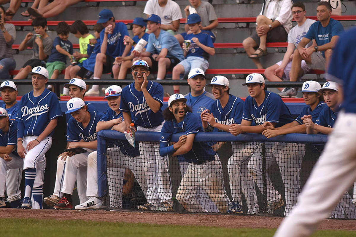 Players of the Darien baseball team root for a teammate at the plate during the FCIAC championship game in May at Cubeta Stadium in Stamford. - Dave Stewart photo