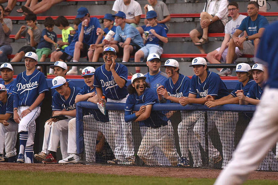 Players of the Darien baseball team root for a teammate at the plate during the FCIAC championship game in May at Cubeta Stadium in Stamford. — Dave Stewart photo