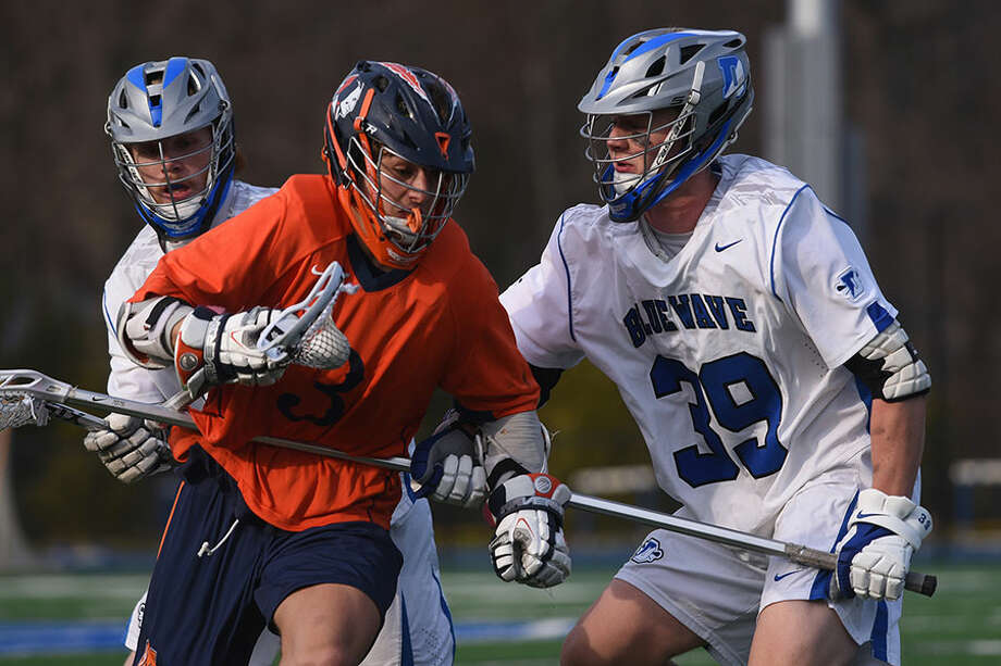 Darien's Andrew Darby (39) plays lockdown defense against Manhasset during a dramatic Wave win this spring. Darby, who was often tasked with guarding opposing team's best offensive players, will be continuing his lacrosse career with the Michigan Wolverines. — Dave Stewart photo