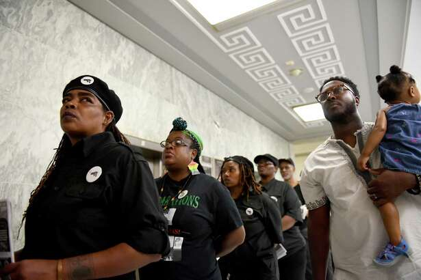 People jam the hallways of the Rayburn House Building in order to get into a reparations hearing on Wednesday, June 19, 2019.