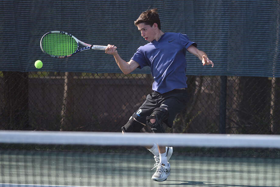 Bobby Neuner, shown in action during a win against rival New Canaan, has been a four-year leader for the Darien boys tennis team, and is now joining the Washington & Lee Generals for his college career. — Dave Stewart photo