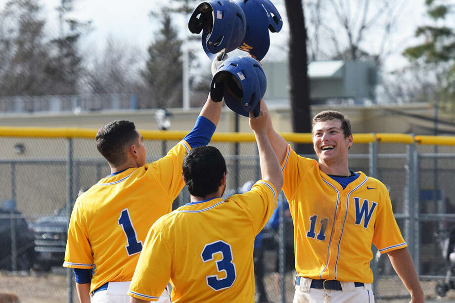 Darien's Jamie Schofield (11) celebrates with teammates after hitting a home run this spring. — Western New England Athletics photo
