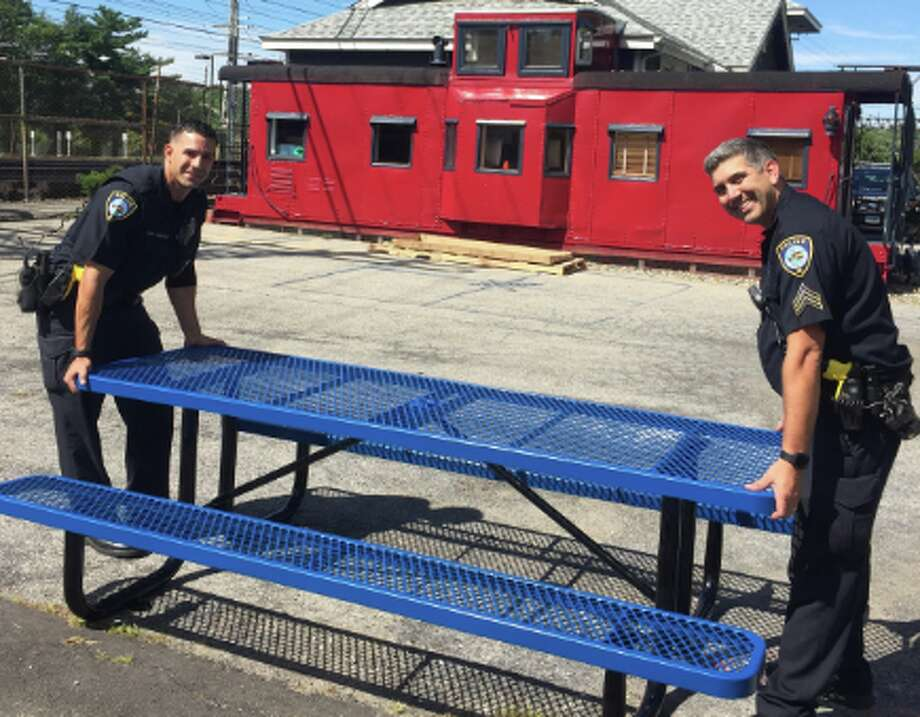 Darien Police officers recently assisted The Depot Youth Center in assembling new picnic tables for its outdoor area.